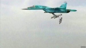 A still image taken from video footage and released by Russia's Defence Ministry on August 18 shows a Russian Sukhoi Su-34 fighter bomber based at Iran's Hamadan air base dropping bombs in the Syrian province of Deir ez-Zor. /Reuters