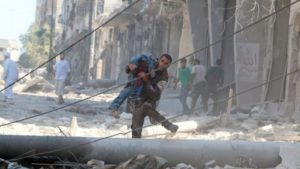 A man carries an injured man amid rubble of damaged buildings after an airstrike in Aleppo. /Reuters