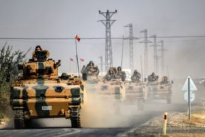 Turkish army tanks drive to the Syrian-Turkey border town of Jarabulus on Aug. 25. /AFP/Bulent Kilic