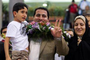 Iranian scientist Shahram Amiri at the Imam Khomeini Airport in Tehran on July 15, 2010. / Reuters