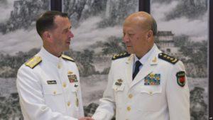 Adm. John Richardson with Chinese naval commander Adm. Wu Shengli in Beijing on July 18.