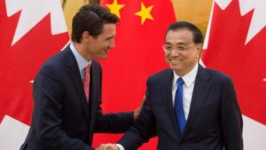 China's Li Keqiang with Canada's Justin Trudeau at the Great Hall of the People in Beijing, on Aug. 31. / Adrian Wyld / Canadian Press
