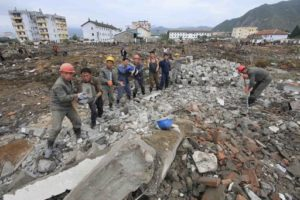 Workers in the flood-damaged areas in Onsong, North Hamgyong Province, North Korea, on Sept. 16. / Kim Kwang Hyon / AP Photo