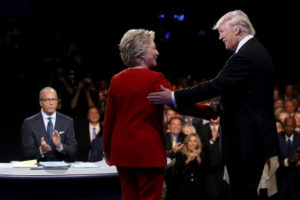 Donald Trump, Hillary Clinton and debate moderator Lester Holt. /Getty Images