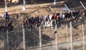 Dozens of migrants waited for hours atop the fence in Ceuta. /YouTube