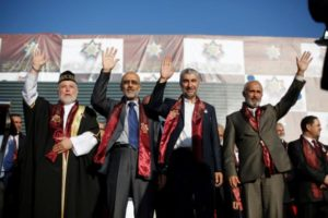 Islamic Action Front candidates wave to supporters at a rally in Amman. /Reuters