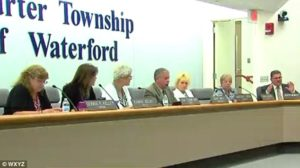 Waterford Township trustees discuss refugee resettlement on Oct. 24. /WXYZ