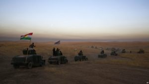 A Kurdish Peshmerga convoy heads toward the frontline east of Mosul on Oct. 17. /AP