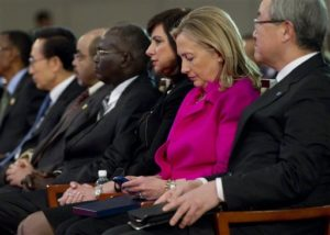 Hillary Clinton checks her BlackBerry. /AP