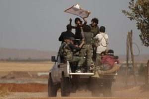 Syrian rebel fighters advancing toward Dabiq, Syria. / Reuters
