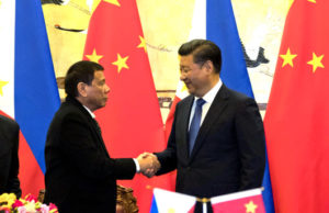 Philippine President Rodrigo Duterte, left, with Chinese President Xi Jinping after a signing ceremony in Beijing on Oct. 20. / Ng Han Guan / AP