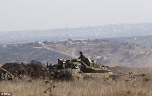 Israeli soldiers on a tank near the village of Ma'rbah, in the southern Golan Heights, today after a clash with gunmen from a group which swears allegiance to ISIL. /EPA