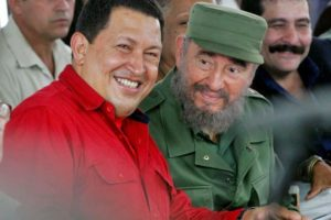 The late dictator of Venezuela Hugo Chavez, left, with the late dictator of Cuba Fidel Castro. / Claudia Dauf / Reuters