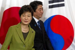 South Korean President Park Geun-Hye, left, and Japanese Prime Minister Abe at a meeting in March at the U.S. ambassador's residence in The Hague. / AFP / Getty Images