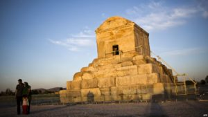 An Iranian family poses next to the tomb of Cyrus II of Persia, known as Cyrus the Great, in the town of Pasargad. / AFP