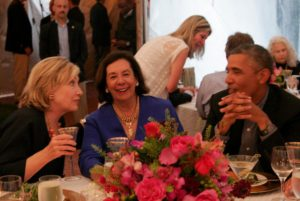 Hillary Clinton and President Barack Obama chat during a birthday party for Vernon Jordan's wife, Ann Jordan, center, on Aug. 15, 2014 on Martha's Vineyard. /Nancy Ellison/Polaris