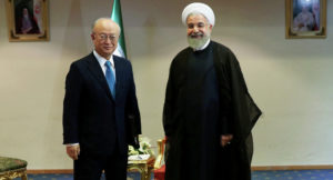 IAEA head Amano meets with Iranian President Hassan Rouhani on Dec. 18. /AP
