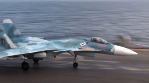 Su-33 fighter on the deck of Admiral Kuznetsov aircraft carrier.