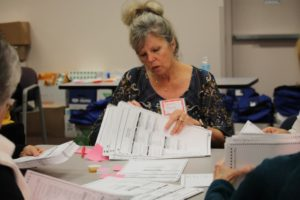 Connie Tews counts ballots in Kenosha, Wisconsin, at the request of Green Party candidate Jill Stein on Dec. 2. /AFP/Getty Images