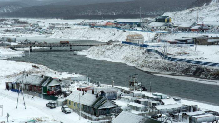 Putin, Abe talk sanctions, northern islands at hot springs summit