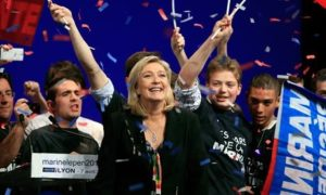 Marine Le Pen with supporters at an election rally in Lyon. /AP