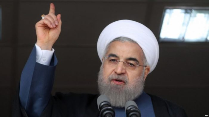 Iran' Rouhani to Obama: Veto extension of sanctions or else