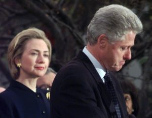 First lady Hillary Rodham Clinton watches President Clinton pause as he thanks those Democratic members of the House of Representatives who voted against impeachment on Dec. 19, 1998. /AP