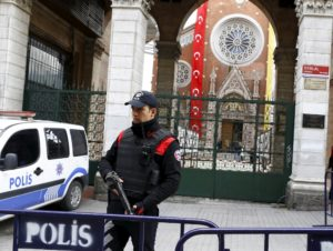 A Turkish police officer stands guard in front of St. Antouan Church in Istanbul. /Reuters