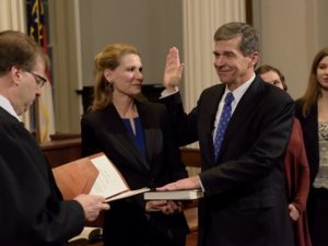 North Carolina Gov. Roy Cooper took his oath of office minutes after midnight on Jan. 1 in Raleigh. /Twitter