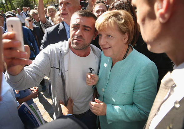 Merkel changes her tune, will pay migrants to leave Germany