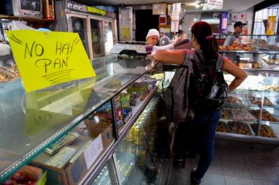 Amid bread shortage, Venezuela seizes bakeries, arrests bakers
