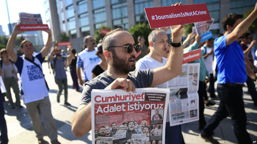 Trial opens for 17 Turkish journalists in key press freedom case
