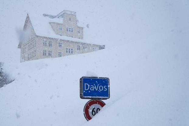Global elites fly into Davos, risk snow drifts and avalanche threats to address global warming