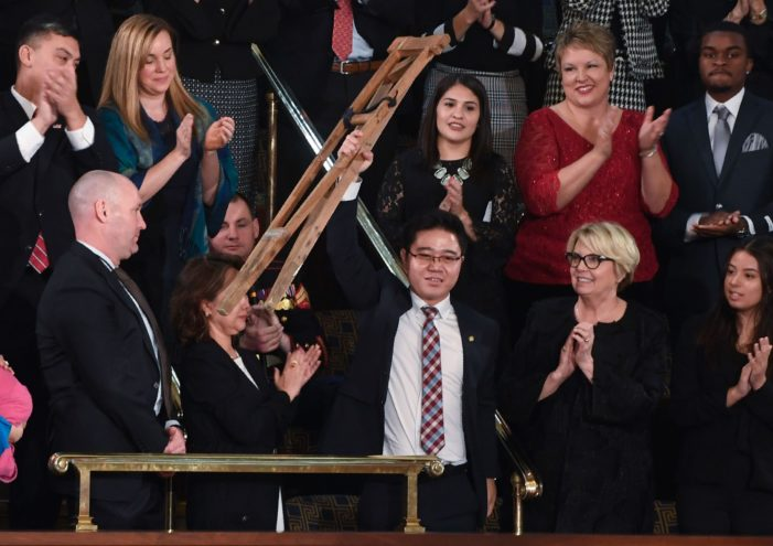 Riveting State of the Union moment: North Korean defector waves crutches in defiance