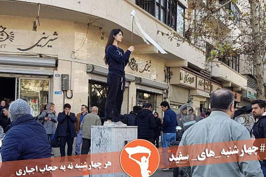 Iranian women removing hijab charged with 'inciting prostitution'