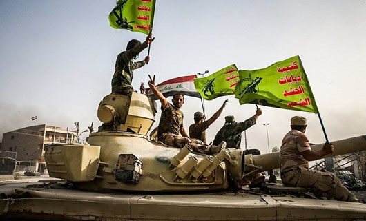 Iran-linked militias, opposed by U.S., inducted into Iraqi security forces