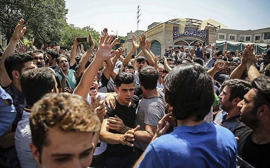 Iranians take to the streets over economy, currency devaluation
