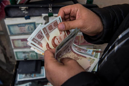 Iran's currency falls to record low, discontent speads as U.S. sanctions loom