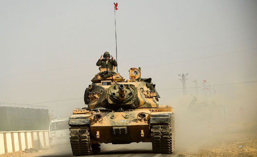 Turkish troops, tanks move into northern Syria following U.S. announcement