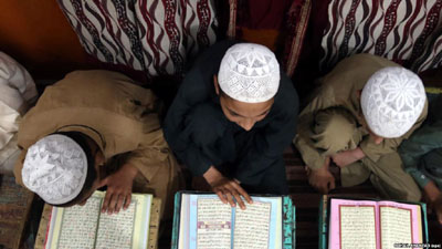 Pakistan denies its takeover of religious schools was due to international pressure