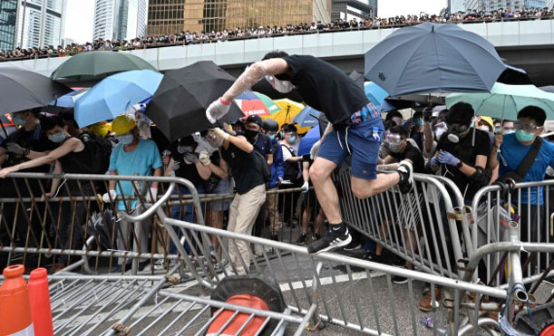 As protests turn violent, State Dept. issues warning to Hong Kong government