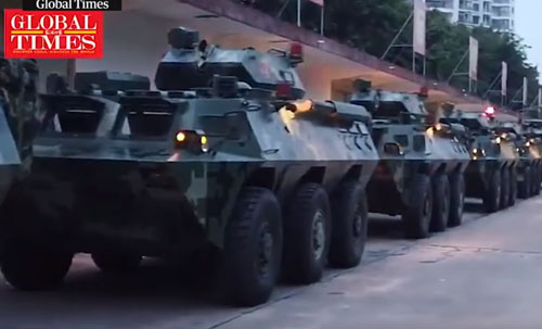 China's state media show 'scheduled' troop movements to Hong Kong, by land and sea