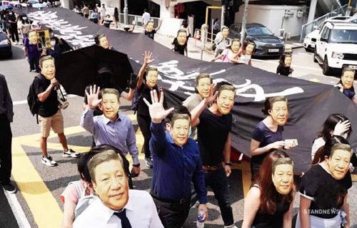 'Bones ground to powder,' Xi warns; Hong Kong protesters don Xi masks