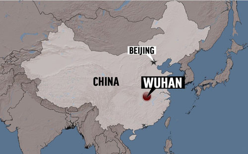 Long waits to pick up urns in Wuhan raise questions about official death toll