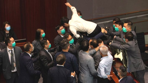 'We are forced': Hong Kong lawmakers see physical fights as last resort