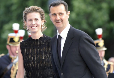 U.S. sanctions Syria's Assad and wife, turns up heat for political solution