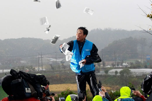 Defector tries to reach countrymen with real news; Seoul teams with Pyongyang to stop him