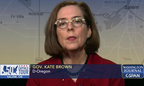Oregon governor: Call cops on Thanksgiving covid violators