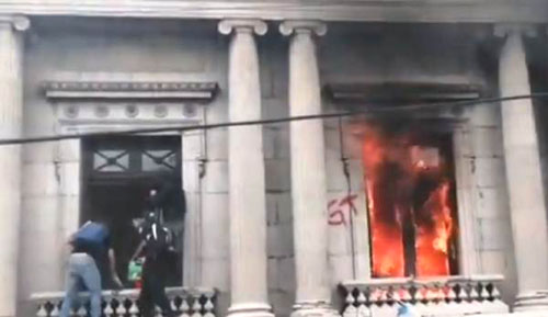 Last straw: In protest of runaway government corruption, Guatemalans burn their Congress