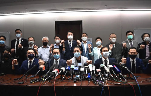 China seen eliminating political dissent in Hong Kong as opposition bloc resigns en masse